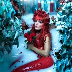 Red Latex Clothing in a milk bath. Think Westward Bound meets Cleopatra at Christmas.