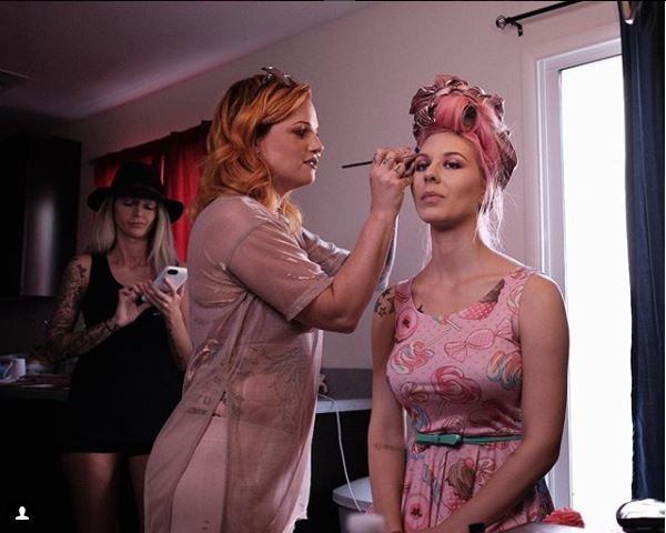 Candid moment behind the scenes on latex clothing and cosmetics project